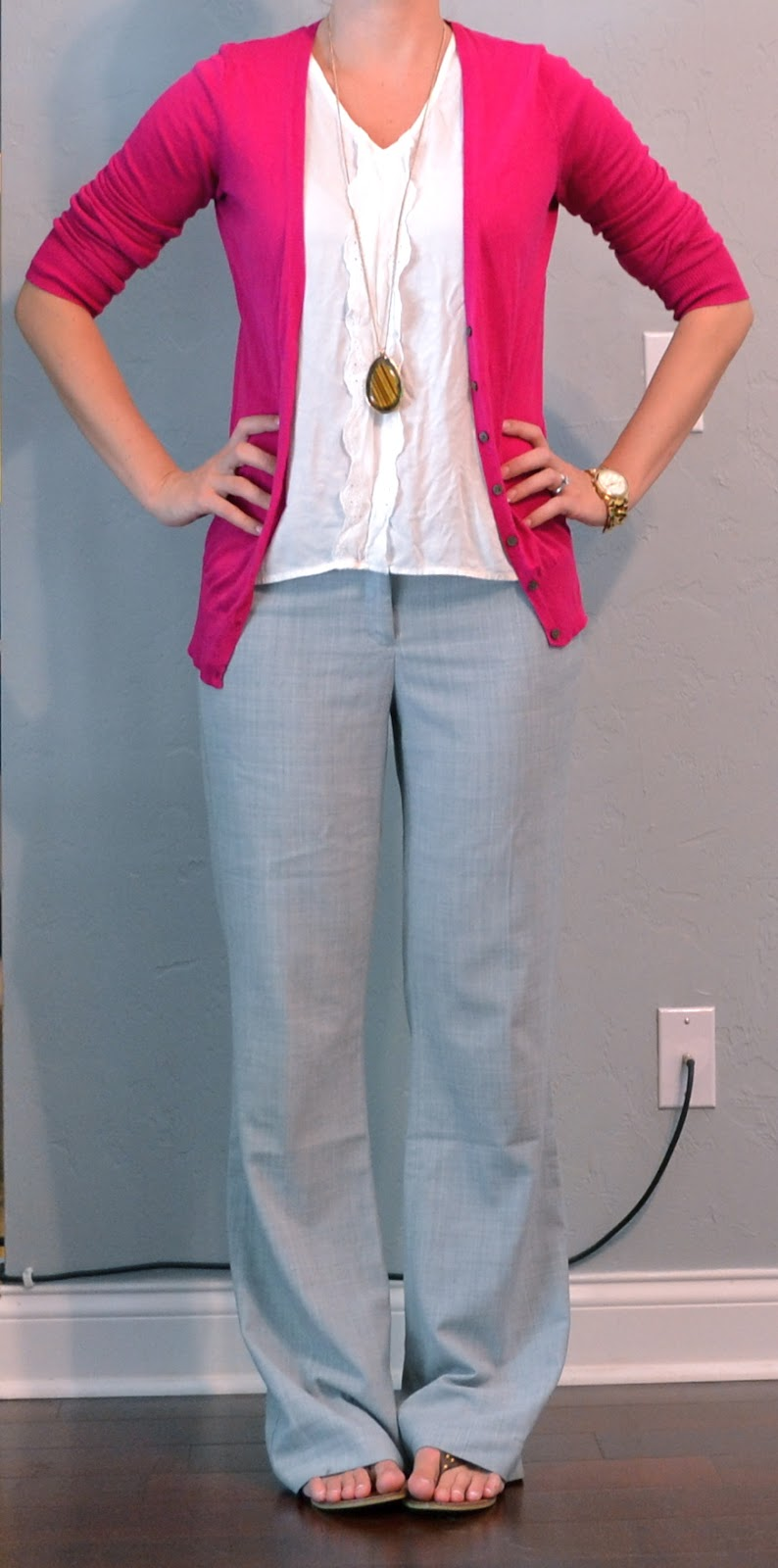 outfit posts pink cardigan grey pants white top flip flops