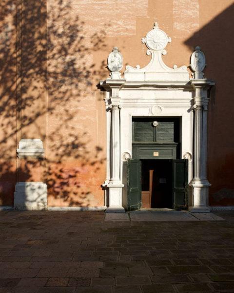 A church door with shadows in Venice, Italy