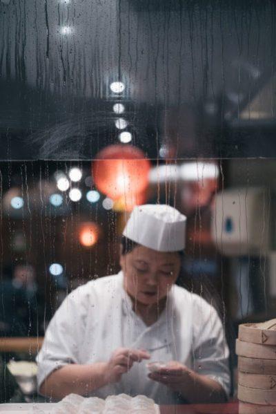A woman making dumplings in London, UK
