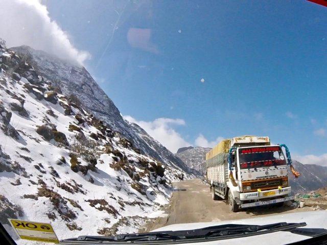 Trucks driving through the mountains in Arunachal Pradesh, India's northeastern region