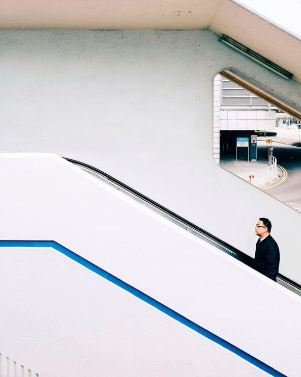 A man on an escalator in Hong Kong