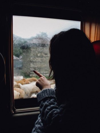 Woman looking out a window