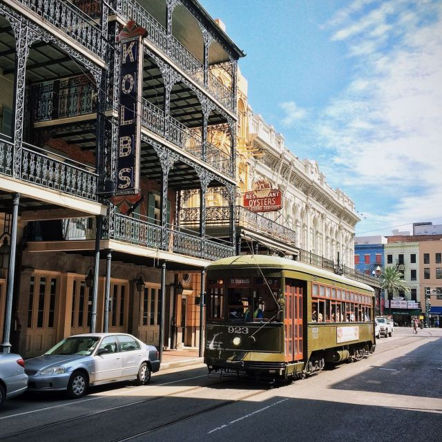 A trolley riding through the streets of New Orleans