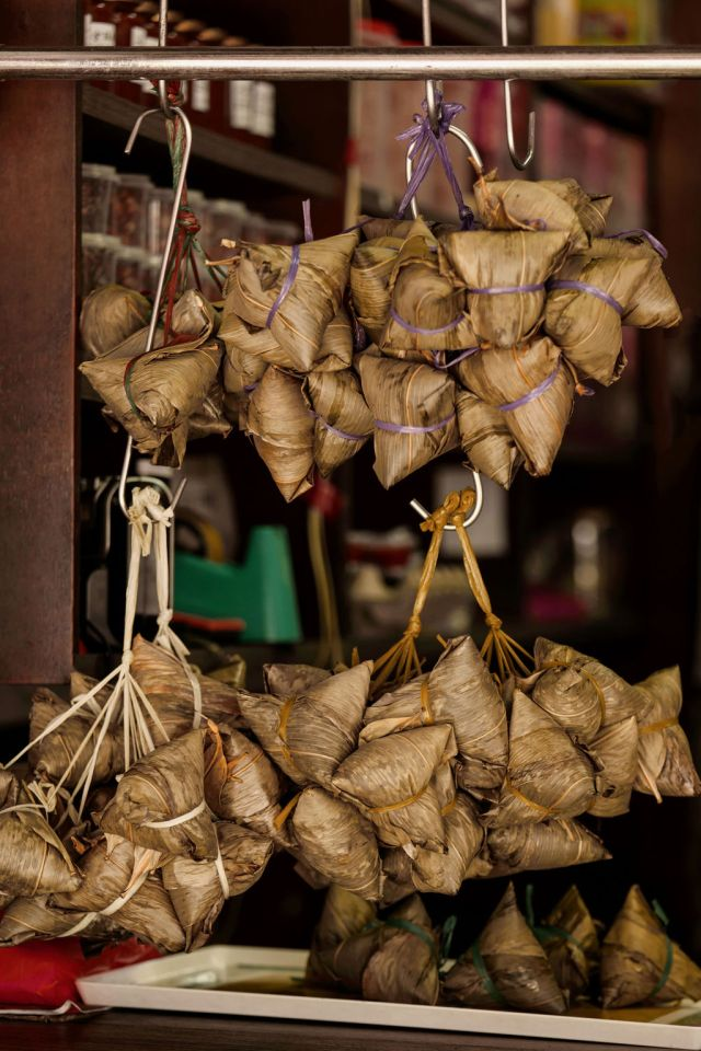 Wrapped rice dumplings hanging at a food stall in Singapore's Katong/Joo Chiat Neighborhood