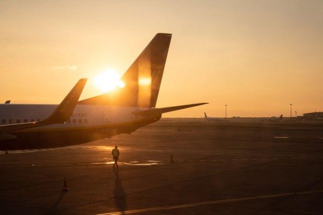 A plane on a runway at dawn