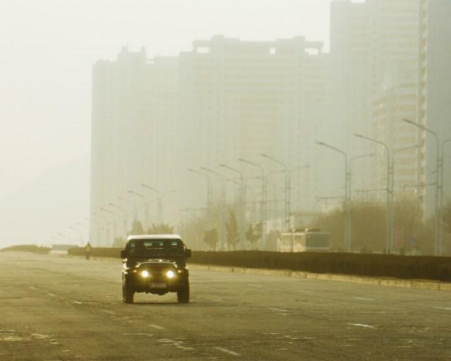 A lone jeep on an empty street in Pyongyang, North Korea