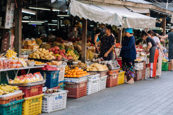 Merchants display their fruit and food wares in Chiang Mai in a photo by creative Denis Amirtharaj.