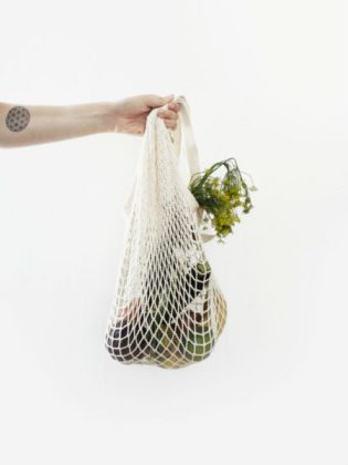 White mesh produce bag full of vegetables