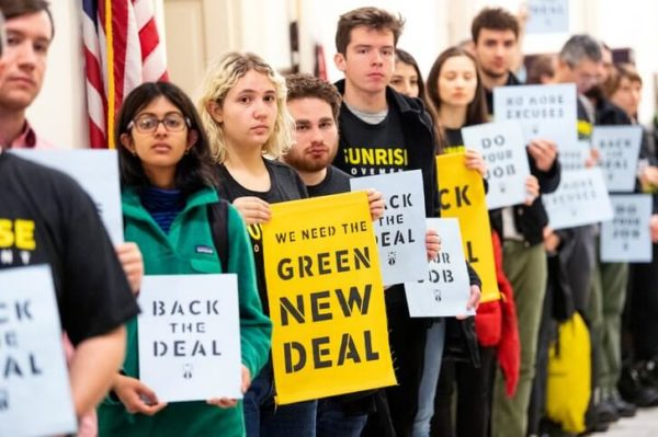 """Student members of the Sunrise Movement demonstrate in support of Alexandra Ocasio-Cortez's climate change legislation the """"green new deal."""""""