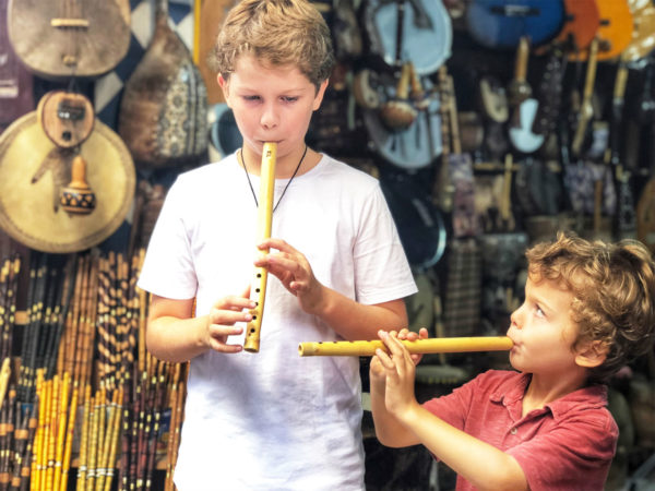Two boys play recorders in Morocco
