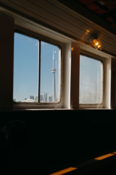 Toronto's CN tower seen through the window of a ferry.