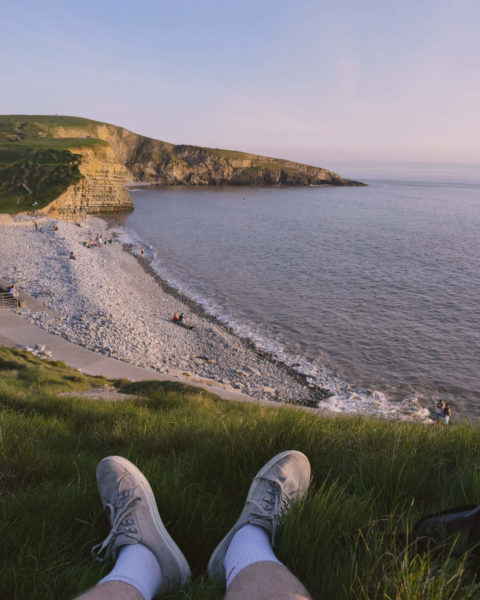 a hilltop view of a seaside sunset.