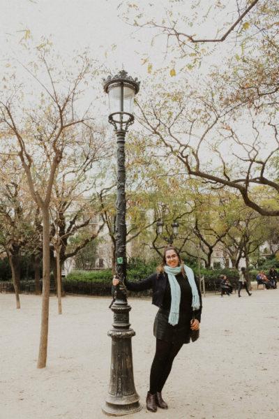 Justine swings on lamp post in Barcelona