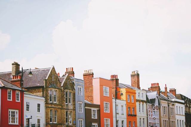 a colorful row of houses against the sky in london