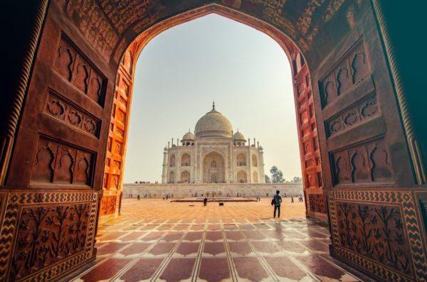 the taj mahal framed through a doorway