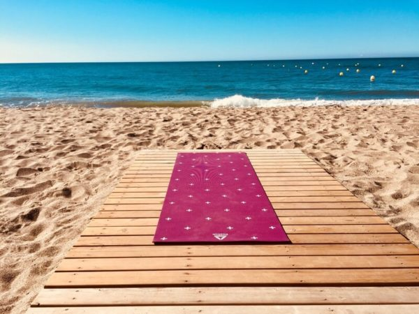 recycled plastic yoga mat by seaside