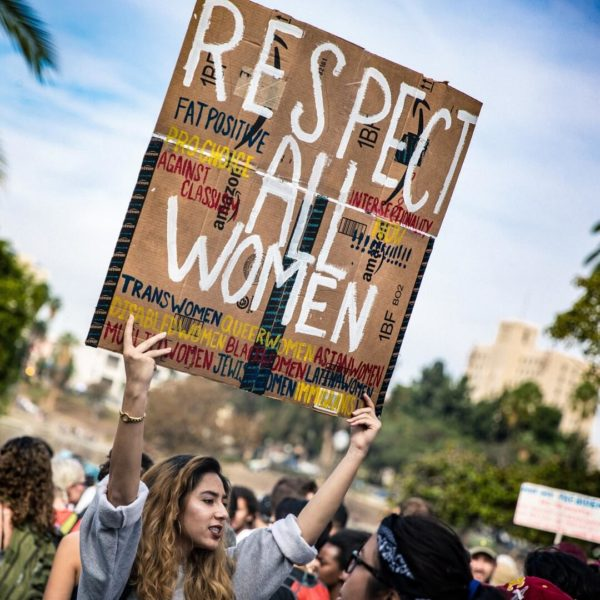 protester holding respect all women sign