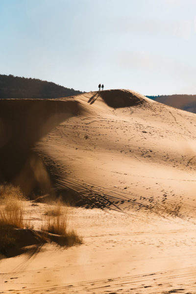 desert dune with two distant figures
