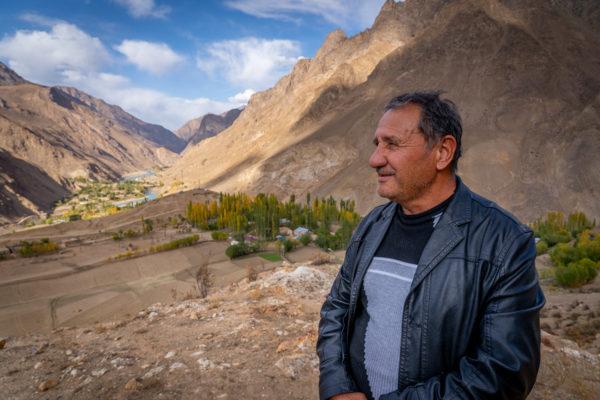 man overlooking mountain valley
