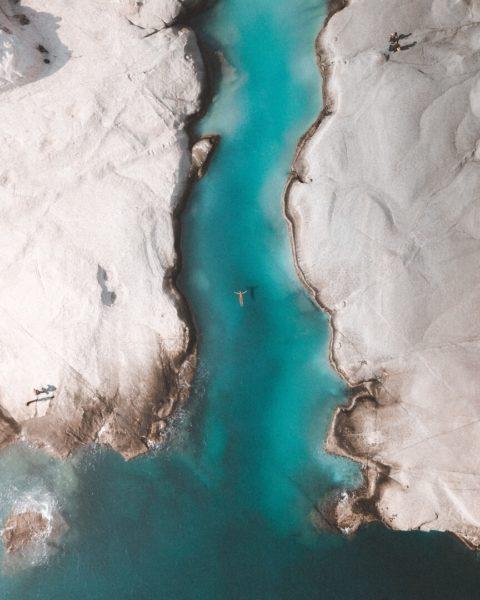 swimmer in blue lagoon