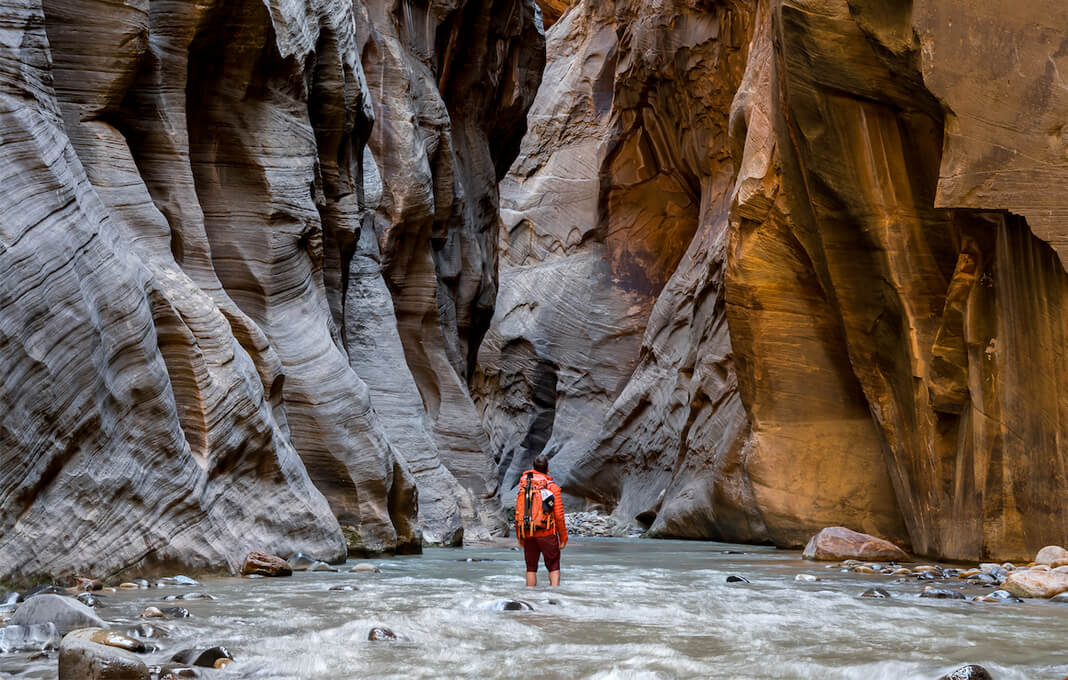 backpacker in canyon ravine