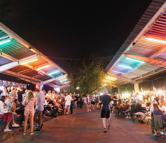 warsaw night market under neon lights
