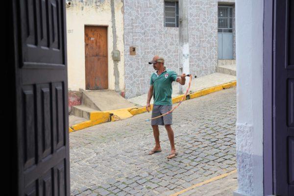 man holding whip in street