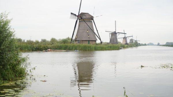 windmills along river
