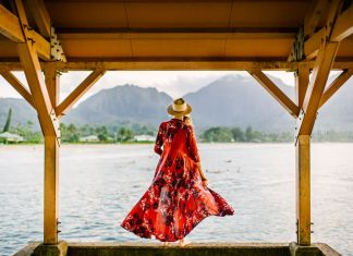 woman in red dress on dock