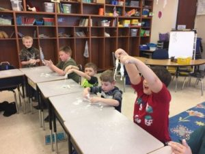 Students experimenting with Oobleck and it's properties.