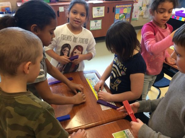 students exploring magnets