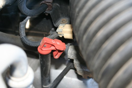 small resolution of locate the purge solenoid valve on the left side of the engine about halfway down it has a hose and wire leading to it from the rear of the car