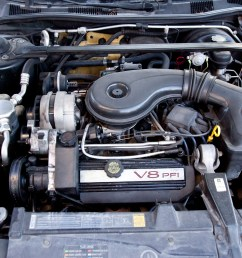 open the hood and disconnect the negative battery cable clamp from the negative battery terminal using a socket wrench turn the nut on the cable clamp  [ 3000 x 2000 Pixel ]