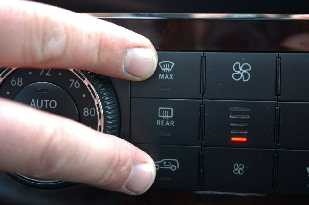 medium resolution of press and hold the defrost and recirculated air buttons simultaneously the defrost button has three lines going through it while the recirculated air
