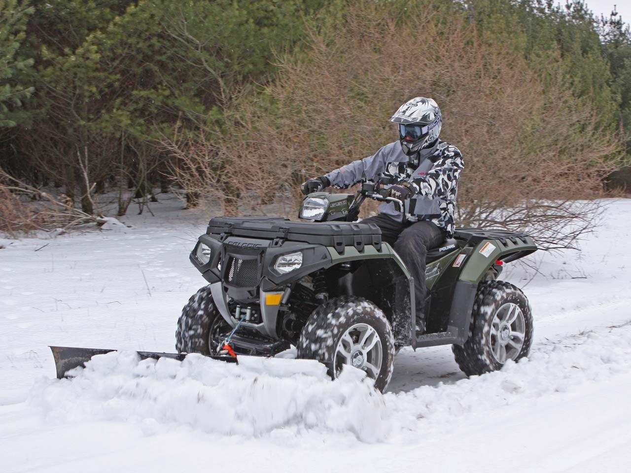 hight resolution of winter atv plowing