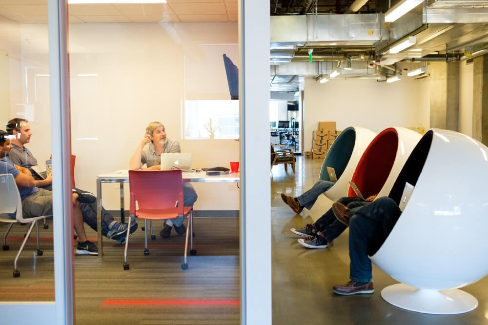 chair massage seattle wine cork inside the life of product team at qualtrics ben and wayne are on a conference call with members in provo utah other side wall work sound quieting chairs