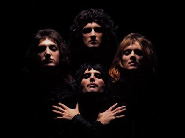 Queen members posing for