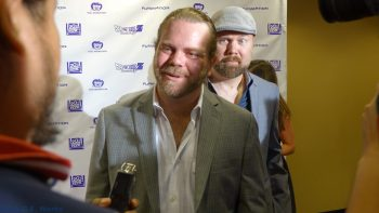 Christopher Sabat with a great photobomb of Justin Cook's interview