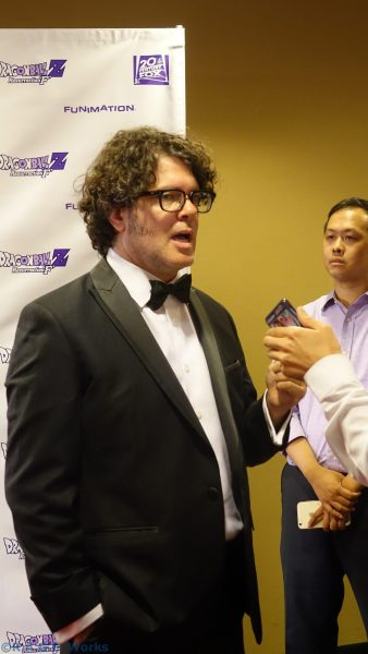 Sean Schemmel chopping it up with the media
