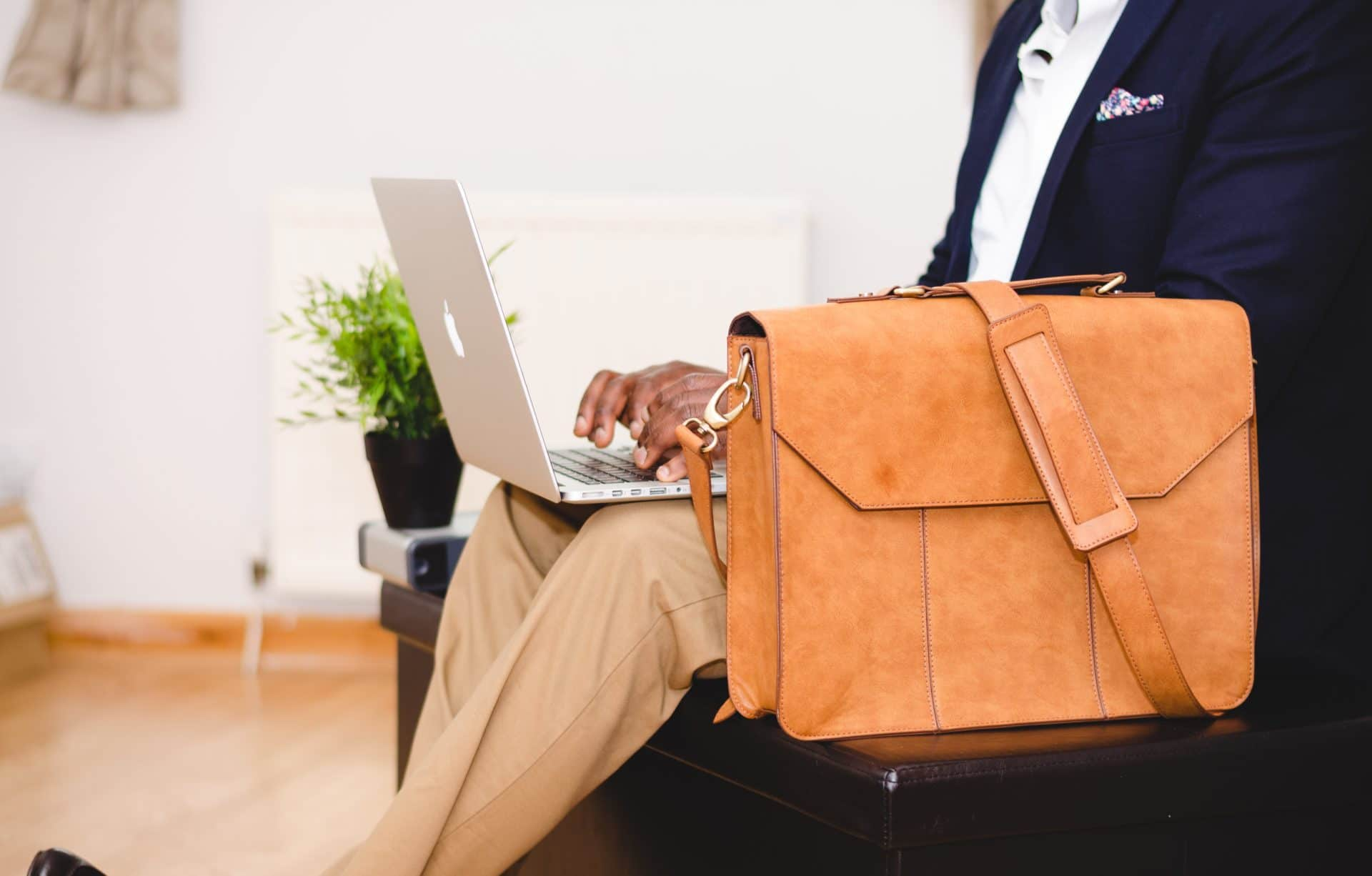 Picture of laptop and briefcase for Real Estate News for Investors Podcast Episode #306