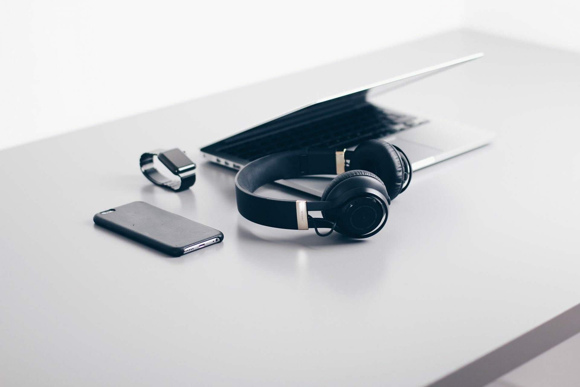 Picture of laptop, watch, iphone headphones for Real Estate News for Investors Podcast Episode #694