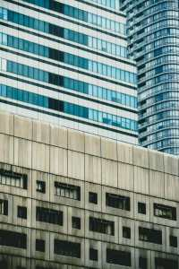 Picture of two buildings for Real Estate News for Investors Podcast Episode #703