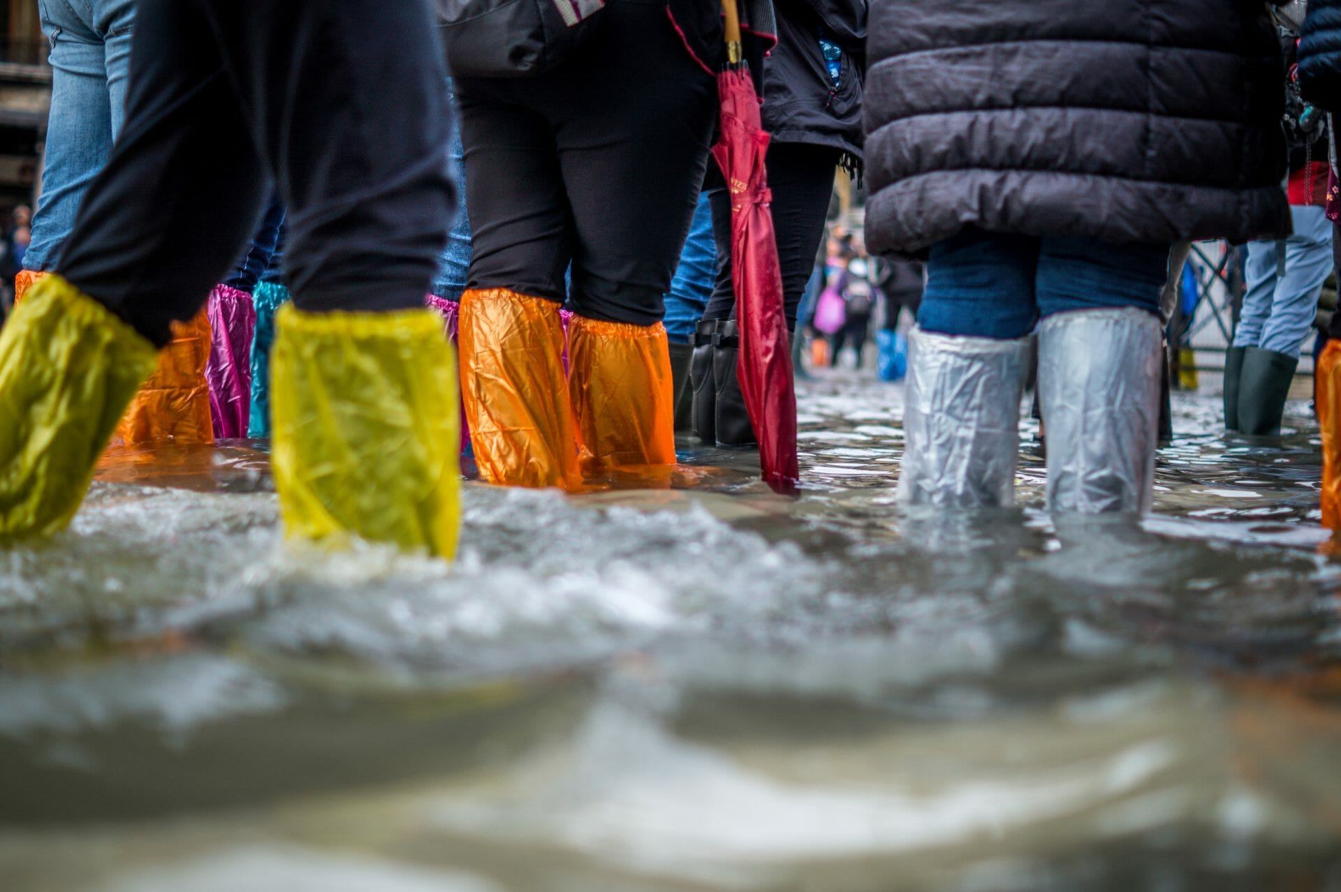 Picture of people wearing shoe covers in flood for Real Estate News for Investors Podcast Episode #707