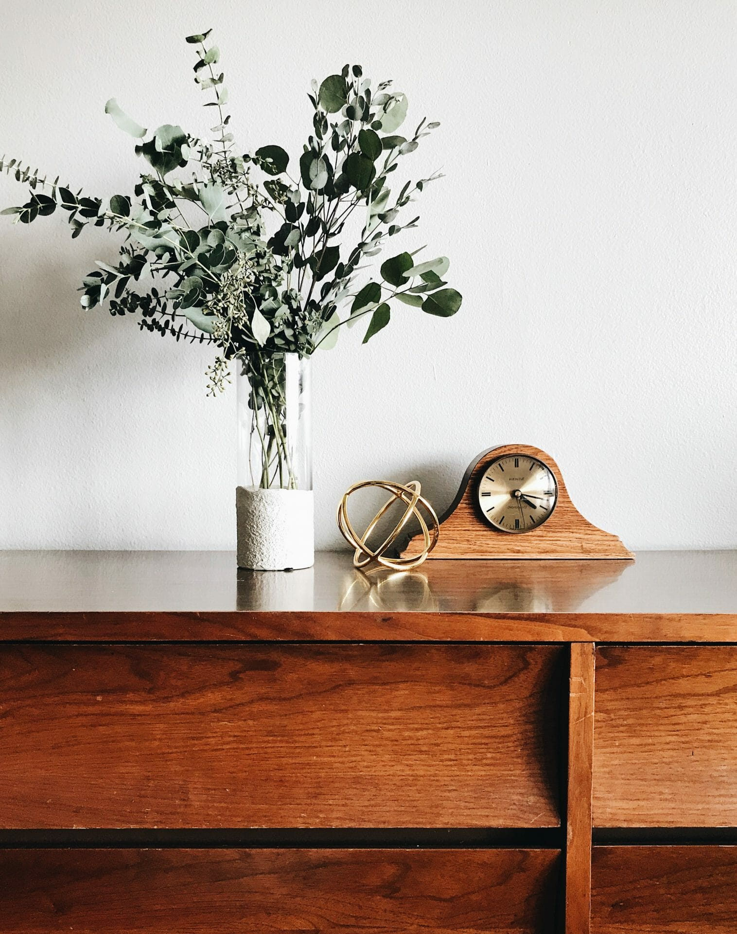 Picture of clock and plant on table for Real Estate News for Investors Podcast Episode #716