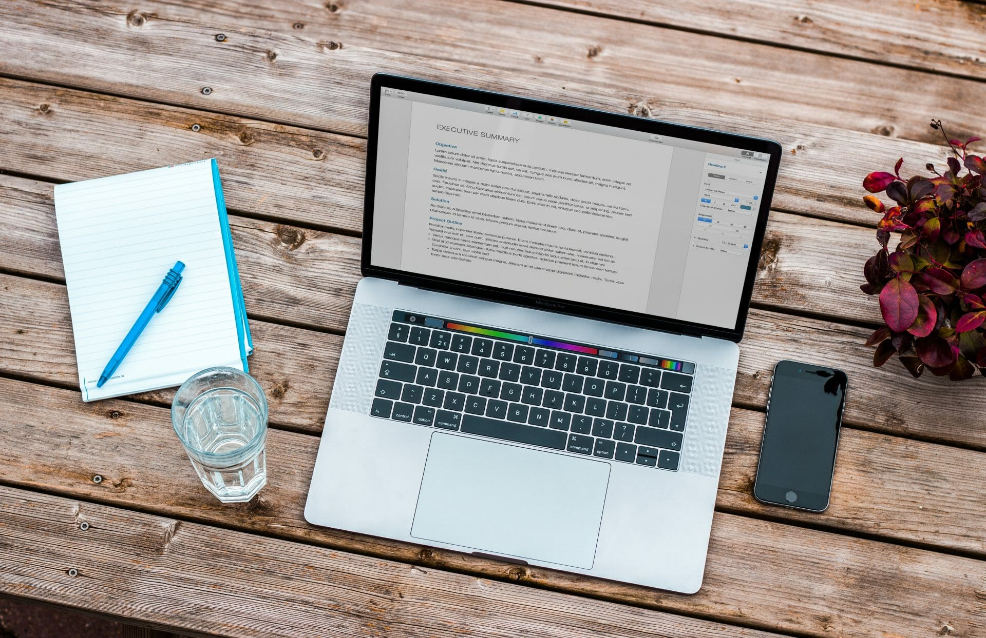 Picture of laptop and water on desk Real Estate News for Investors Podcast Episode #769