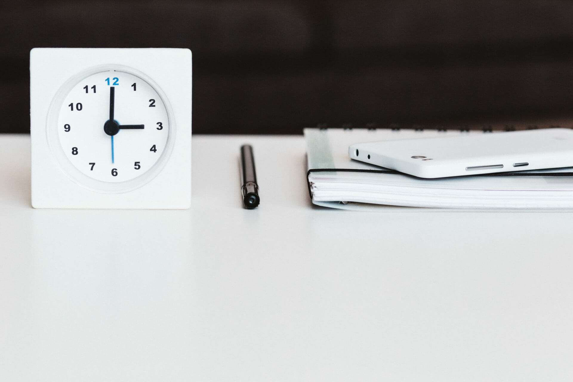 Picture of clock and notebook and phone for Real Estate News for Investors Podcast Episode #774