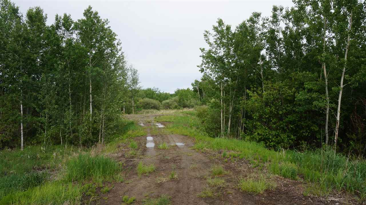 3.59 Acres backing onto a small pond and 15 acre parkland reserve. Cleared building site already set up. Beautiful setting overlooking the trees, bush and pond. Around 5 min to Redwater and about 30 minutes from the Anthony Henday, paved most of the way.