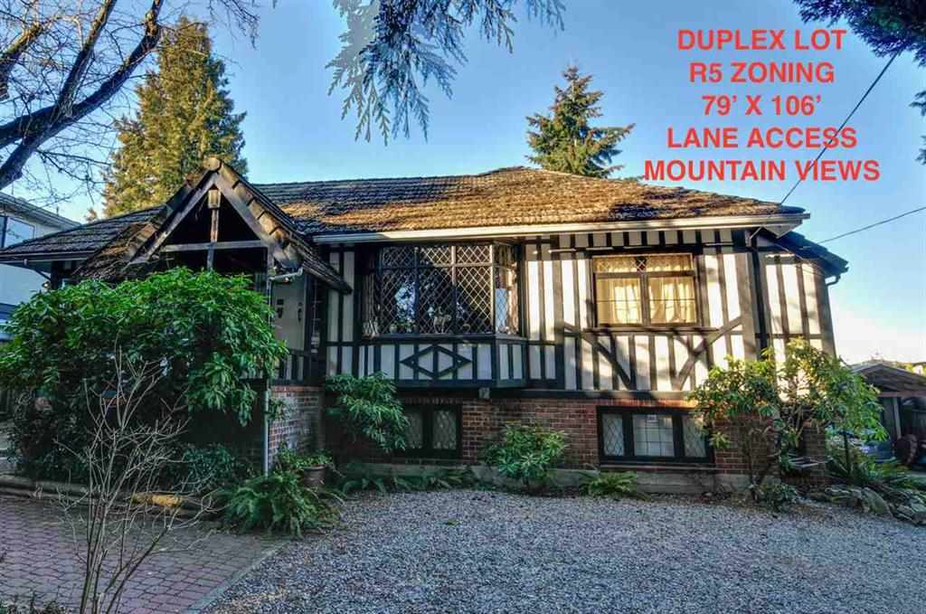 charact house on a big Duplex lot with lane access and mountain view.Potential to buy the north side neighbor to become 3 duplex lot. Excellent holding property current tenanted with $3500/month rental income in a park like private neighourhood. Excellent school catchment:  Inman Elementary&Moscrop Secondary
