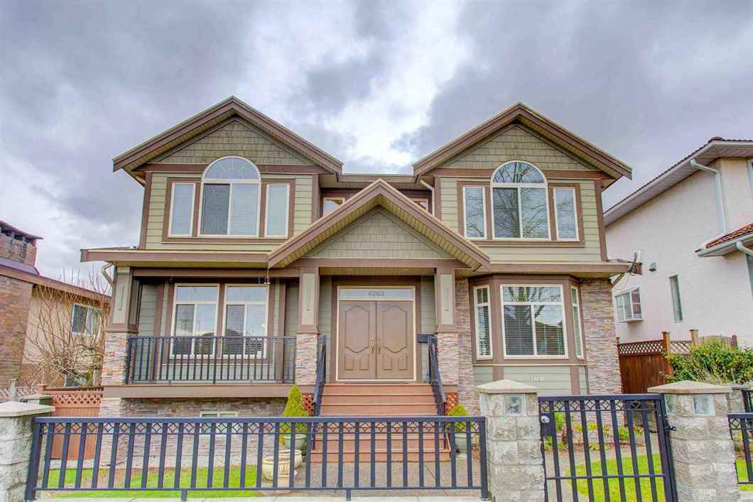This custom built home in an upscale neighborhood has a very nice and practical layout. With over 3,700 sf of luxurious living, it features 7 bedrooms, 5 full bathrooms, 2 kitchens, 1 den, double attached garage with space for RV parking, electric gate and a full basement with separate entry. It is within walking distance to Alpha High and Kitchener Elementary schools, Brentwood Mall, Burnaby Heights' shops and restaurants, transit and Eileen Daily Rec Centre.
