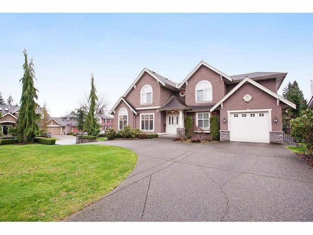 Great family and custom heritage style home in the north burnaby government road  area. House built by Italian builder. Very nice finished in and outside, includes crown mouldings, exotic hardwood and granite floors. Gourmet kitchen has large granite island with cherry cabinets. On the main floor are the dinning and living rooms with vaulted ceilings, panelled den, full bath and laundry. Also five large bedrooms and 3 baths. Finished basement has a cozy suite and media area. The house is close to everything, walking distance to sea forth elementary school, skytrain, Costco and short bus ride to Burnaby mountain secondary school and SFU.